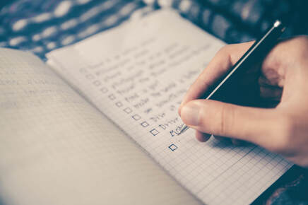 Making a checklist in a notebook